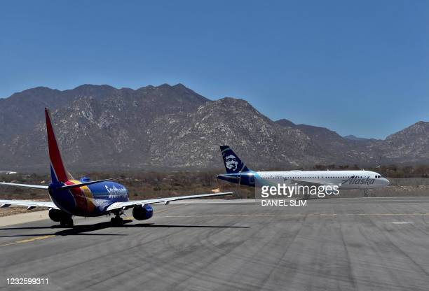 Alaska airlines and Southwest airlines aircrafts wait at the runway for takeoff at the San Jose del Cabo International Airport in Baja California...