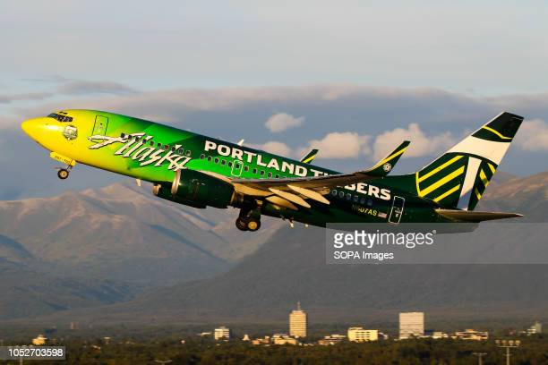 L AIRPORT ANCHORAGE ALASKA UNITED STATES Alaska Airlines departing beautiful Anchorage with their Portland Timbers liveried aircraft