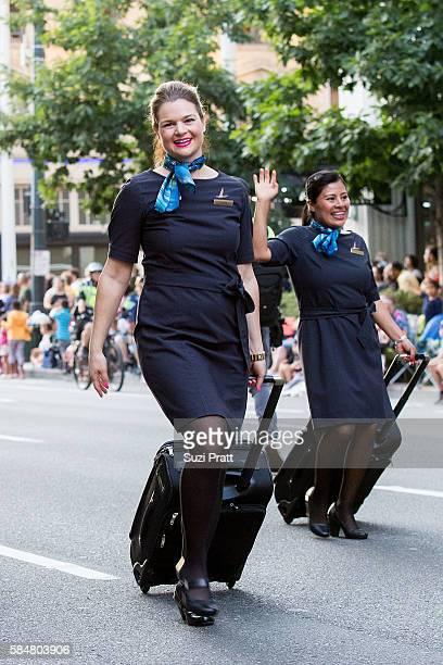 Alaska Airlines flight attendants walk the Seafair Torchlight Parade on July 30 2016 in Seattle Washington