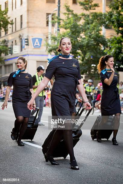 Alaska Airlines flight attendants walk the Seafair Torchlight Parade on July 30 2016 in Seattle Washington
