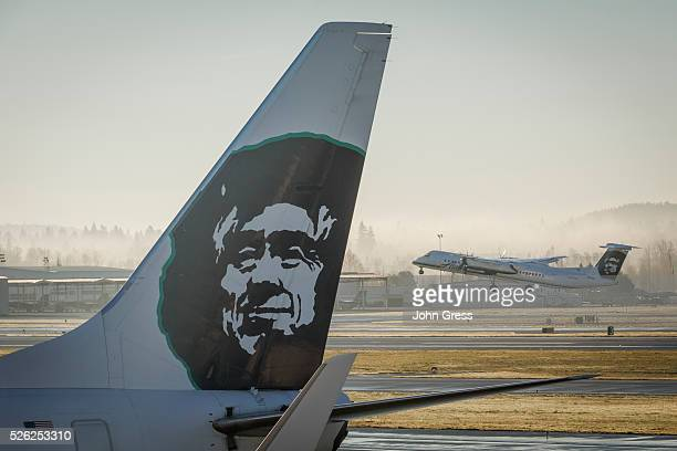 Alaska Airlines Horizon Air Bombardier Q400 plane takesoff at the Portland Oregon International Airport December 30 2015