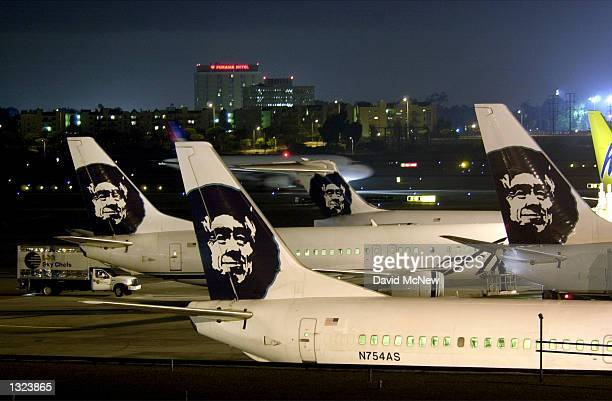 Alaska Airlines jets are parked at their terminal June 21 2001 at Los Angeles International Airport The airport had the highest number of...