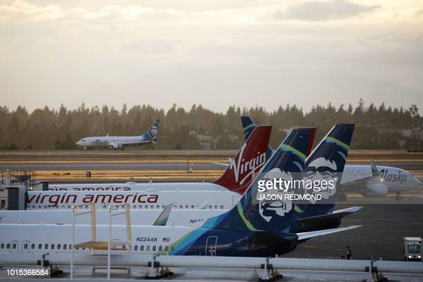 Alaska Airlines planes are pictured at SeattleTacoma International Airport the day after Horizon Air ground crew member Richard Russell took a plane...