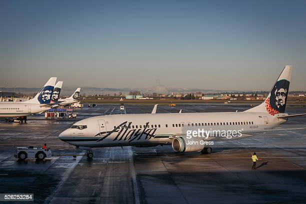 Alaska Airlines planes prepare for takeoff at the Portland Oregon International Airport December 30 2015