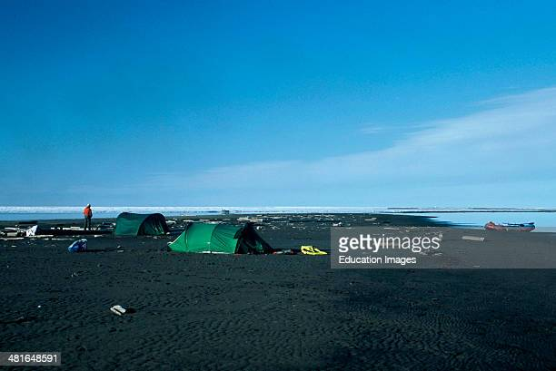 Alaska Arctic National Wildlife Refuge Campsite on Sand Shoal in the Arctic Ocean Raft at shore looking out over ice pack in the ocean