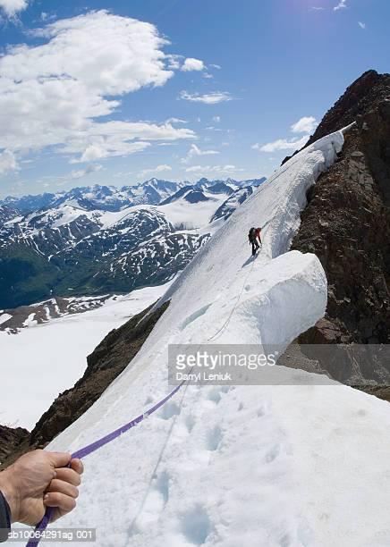 USA, Alaska, Chilkat Mountains, mountaineer climbing peak