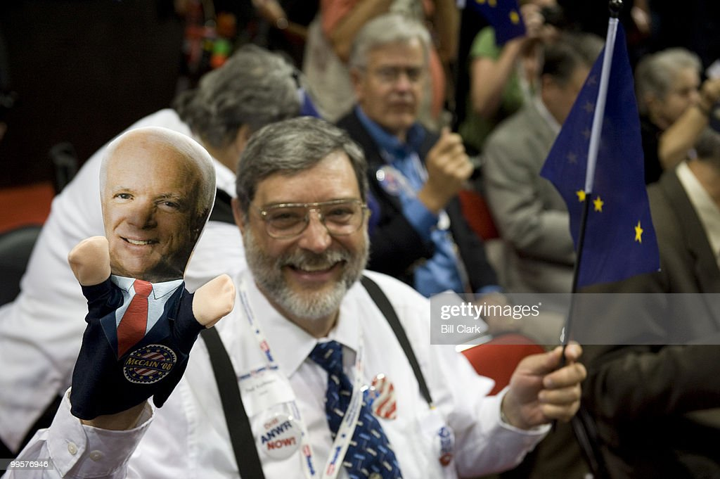 Alaska delegate Paul Verhagen waves his John McCain hand puppet on the floor of the Republican National Convention at the Xcel Center in St. Paul, Minn., on Wednesday, Sept. 3, 2008.