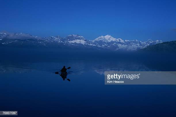 USA, Alaska, Glacier Bay, Queen Inlet, sea kayaker, reflections