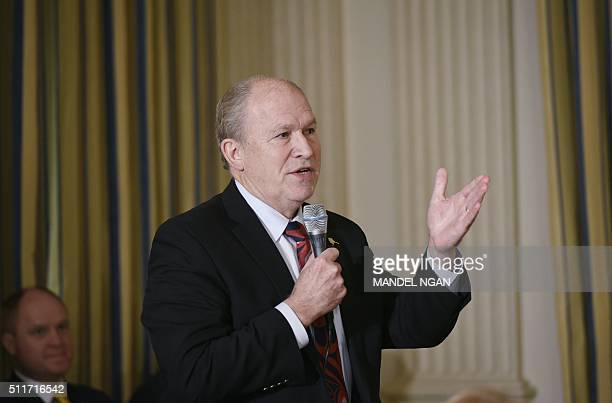 Alaska Governor Bill Walker asks a question of US President Barack Obama after Obama addressed the National Governors Association on February 22 2016...