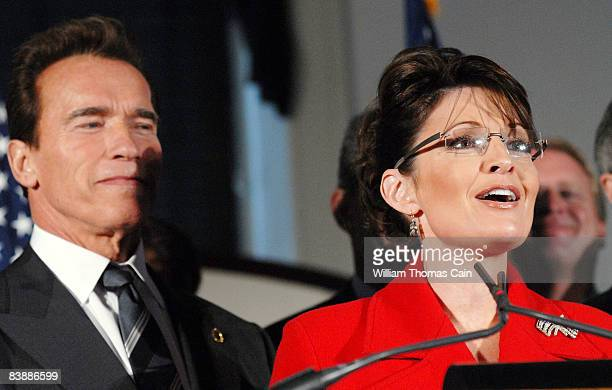 Alaska Governor Sarah Palin answers questions from the media as California Governor Arnold Schwarzenegger listens at the meeting of the National...