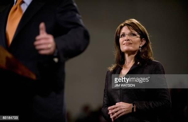 Alaska Governor Sarah Palin listens as her running mate US Republican Presidential Candidate Senator John McCain speaks during a rally at Lehigh...