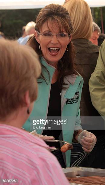 Alaska Governor Sarah Palin serves the public hot dogs before officially resigning during the annual Governor's Picnic July 26 2009 at Pioneer Park...
