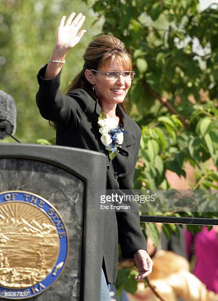 Alaska Governor Sarah Palin waves to the crowd while taking the stage before officially resigning during the annual Governor's Picnic July 26 2009 at...
