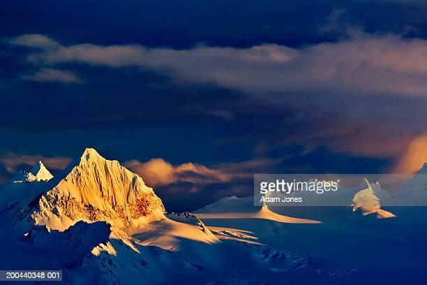 USA, Alaska, Kenai Mountains and storm clouds at sunset