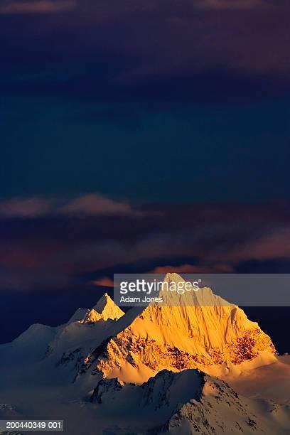usa, alaska, kenai mountains and storm clouds at sunset - kenai mountains stock pictures, royalty-free photos & images