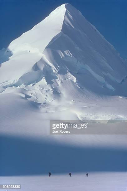Alaska, mountain climbing, Chugach Range. Matanuska Glacier, Three roped climbers from the National Outdoor Leadership School approach a lone, snow...