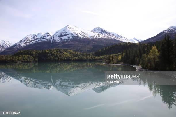 alaska mountain range & reflection - anchorage alaska stock photos and pictures