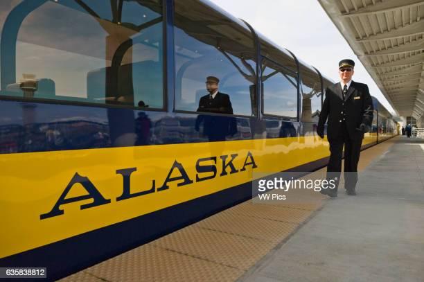 Alaska Railroad passenger car and conductor at Anchorage Airport train depot Anchorage Alaska