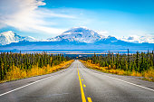 Alaska road trip with mountain and blue sky