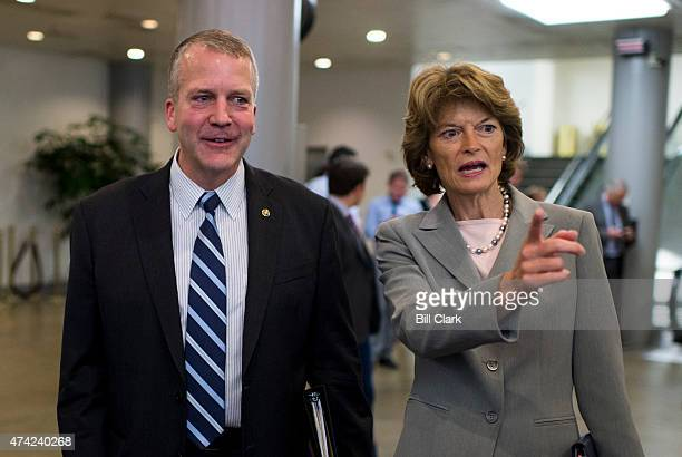 Alaska Senators Dan Sullivan and Lisa Murkowski speak with a group of constituents in the Senate subway as they head to the Senate floor for the vote...