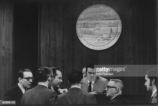 Alaskan state officials inculding Sen Pres Brad Phillips attending Senate committee meetings with oil refinery spokesman during debates over oil land...