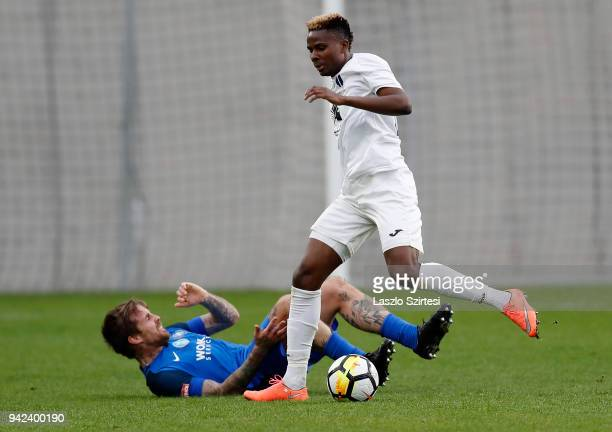 Alassane Diallo of Ujpest FC fouls Adam Vass of MTK Budapest during the Hungarian Cup Quarter Final 2nd Leg match between MTK Budapest and Ujpest FC...