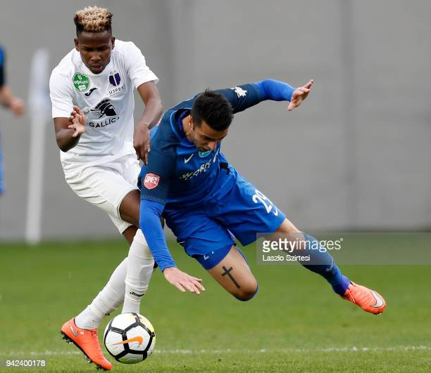 Alassane Diallo of Ujpest FC fouls Laszlo Lencse of MTK Budapest during the Hungarian Cup Quarter Final 2nd Leg match between MTK Budapest and Ujpest...