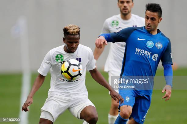Alassane Diallo of Ujpest FC wins the ball from Laszlo Lencse of MTK Budapest during the Hungarian Cup Quarter Final 2nd Leg match between MTK...