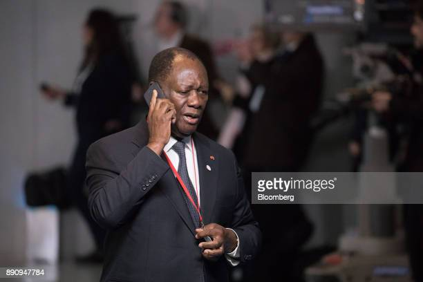 Alassane Ouattara Ivory Coast's president speaks on a phone as he arrives at the One Planet Summit in Paris France on Tuesday Dec 12 2017 French...
