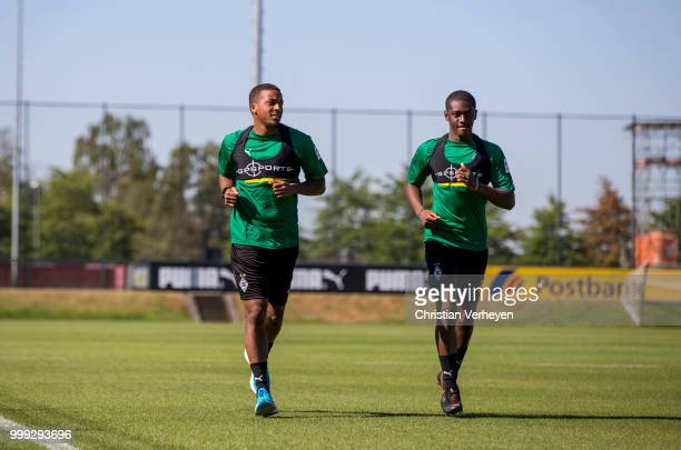 Alassane Plea and Mamadou Doucoure during a training session of Borussia Moenchengladbach at BorussiaPark on July 15 2018 in Moenchengladbach Germany