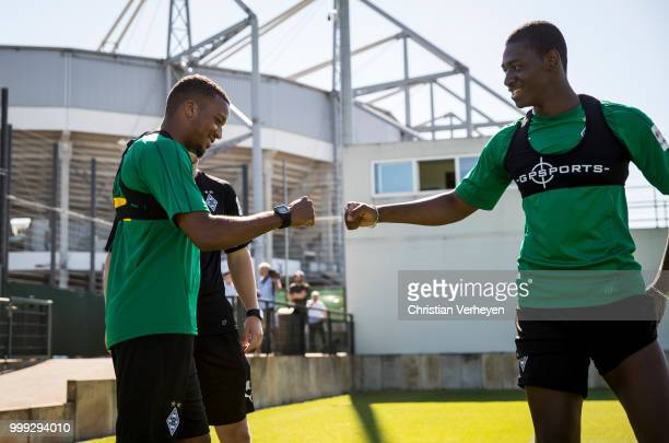 Alassane Plea and Mamadou Doucoure during a training session of Borussia Moenchengladbach at Borussia-Park on July 15, 2018 in Moenchengladbach,...