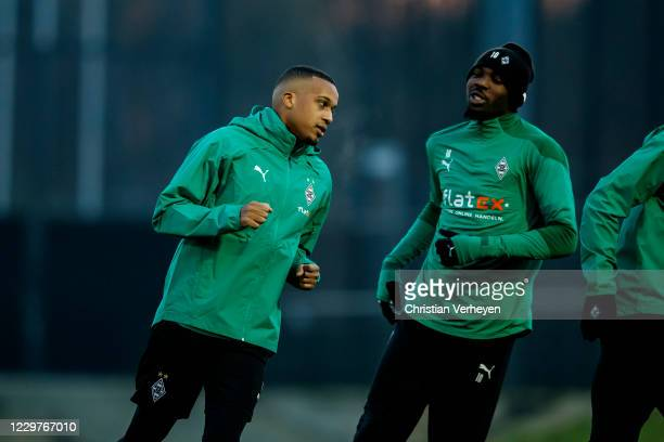 Alassane Plea and Marcus Thuram are seen during a Borussia Moenchengladbach Training session ahead the Group B UEFA Champions League match between...