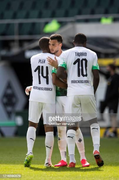 Alassane Plea and Marcus Thuram celebrate during the Bundesliga match between Borussia Moenchengladbach and 1 FC Union Berlin at BorussiaPark on May...