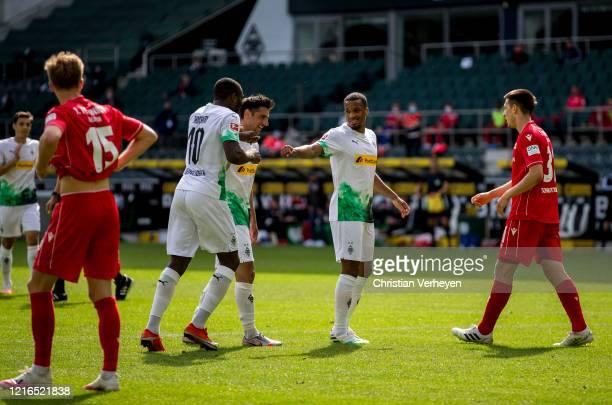 Alassane Plea and Marcus Thuram of Borussia Moenchengladbach celebrate a goal during the Bundesliga match between Borussia Moenchengladbach and 1 FC...