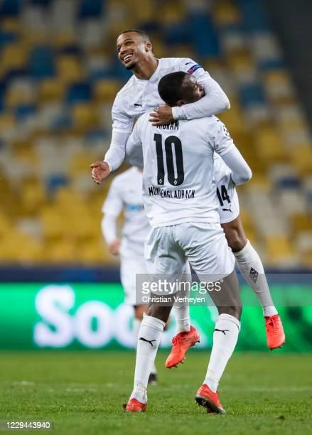 Alassane Plea and Marcus Thuram of Borussia Moenchengladbach celebrate after Alassane Plea scored his teams sixth goal during the Group B - UEFA...