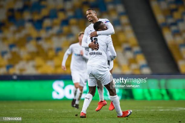 Alassane Plea and Marcus Thuram of Borussia Moenchengladbach celebrate after Alassane Plea scored his teams sixth goal during the Group B - UEFA...
