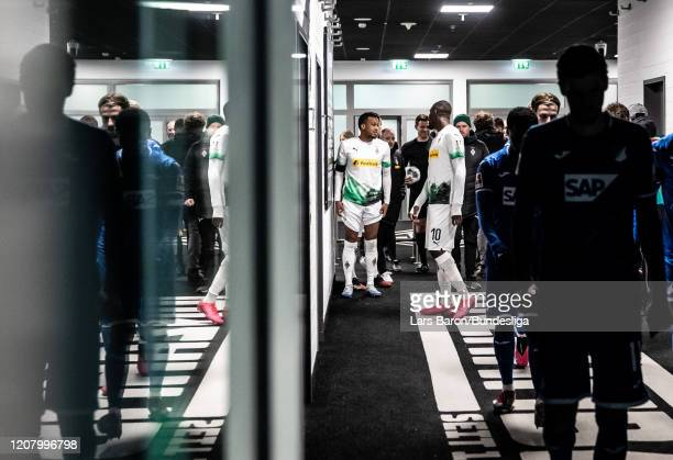 Alassane Plea and Marcus Thuram of Mönchengladbach are seen in the players tunnel during the Bundesliga match between Borussia Mönchengladbach and...