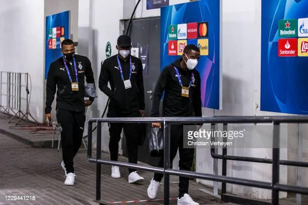 Alassane Plea, Breel Embolo and Ibrahima Traore of Borussia Moenchengladbach are seen before the Group B - UEFA Champions League match between...