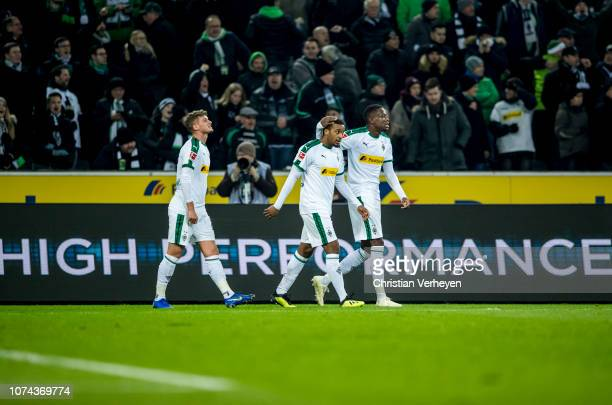 Alassane Plea Michael Cuisance and Denis Zakaria of Borussia Moenchengladbach celebrate after Plea scored a goal for his team during the Bundesliga...