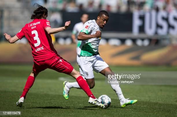 Alassane Plea of Borussia Moenchengladbach and Neven Subotic of Union Berlin battle for the ball during the Bundesliga match between Borussia...