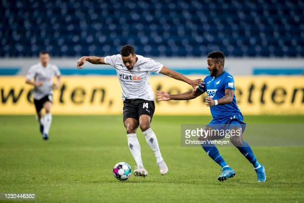 Alassane Plea of Borussia Moenchengladbach and Ryan Sessegnon of Hoffenheim battle for the ball during the Bundesliga match between TSG 1899...