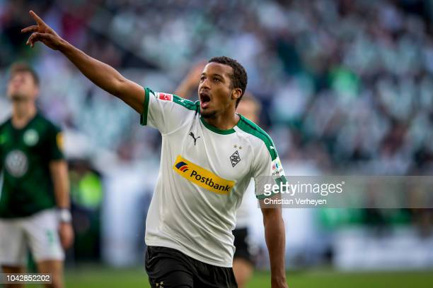 Alassane Plea of Borussia Moenchengladbach celebrate after he score his teams first goal during the Bundesliga match between VfL Wolfsburg and...