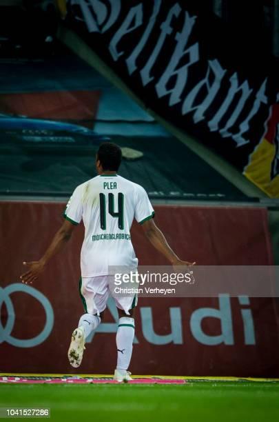 Alassane Plea of Borussia Moenchengladbach celebrate after he scores his teams first goal during the Bundesliga match between Borussia...
