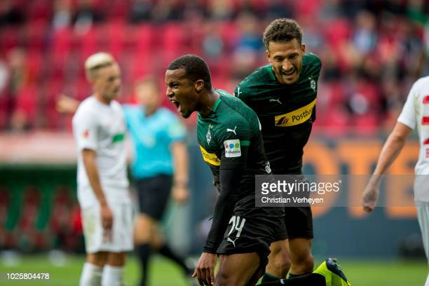 Alassane Plea of Borussia Moenchengladbach celebrate with Fabian Johnson after he score his teams first goal during the Bundesliga match between FC...