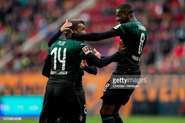 Alassane Plea of Borussia Moenchengladbach celebrate with his team mates after he score his teams first goal during the Bundesliga match between FC...