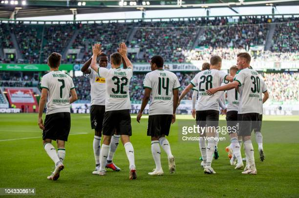 Alassane Plea of Borussia Moenchengladbach celebrate with his team mates after he score his teams first goal during the Bundesliga match between VfL...