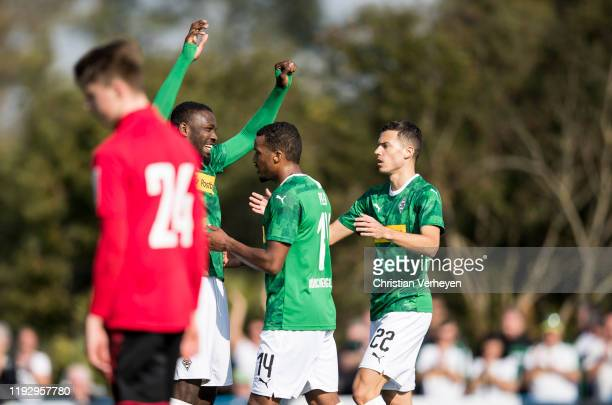 Alassane Plea of Borussia Moenchengladbach celebrate with his team mates after he score his teams second goal during the first friendly match between...