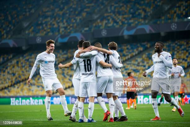 Alassane Plea of Borussia Moenchengladbach celebrate with team mates after he score his teams first goal during the Group B UEFA Champions League...