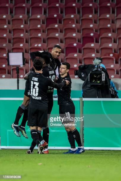 Alassane Plea of Borussia Moenchengladbach celebrate with team mates after he score his teams second goal during the DFB Cup match between VfB...
