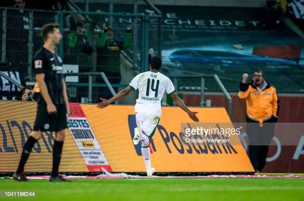 Alassane Plea of Borussia Moenchengladbach celebrates after he scored his teams first goal during the Bundesliga match between Borussia...